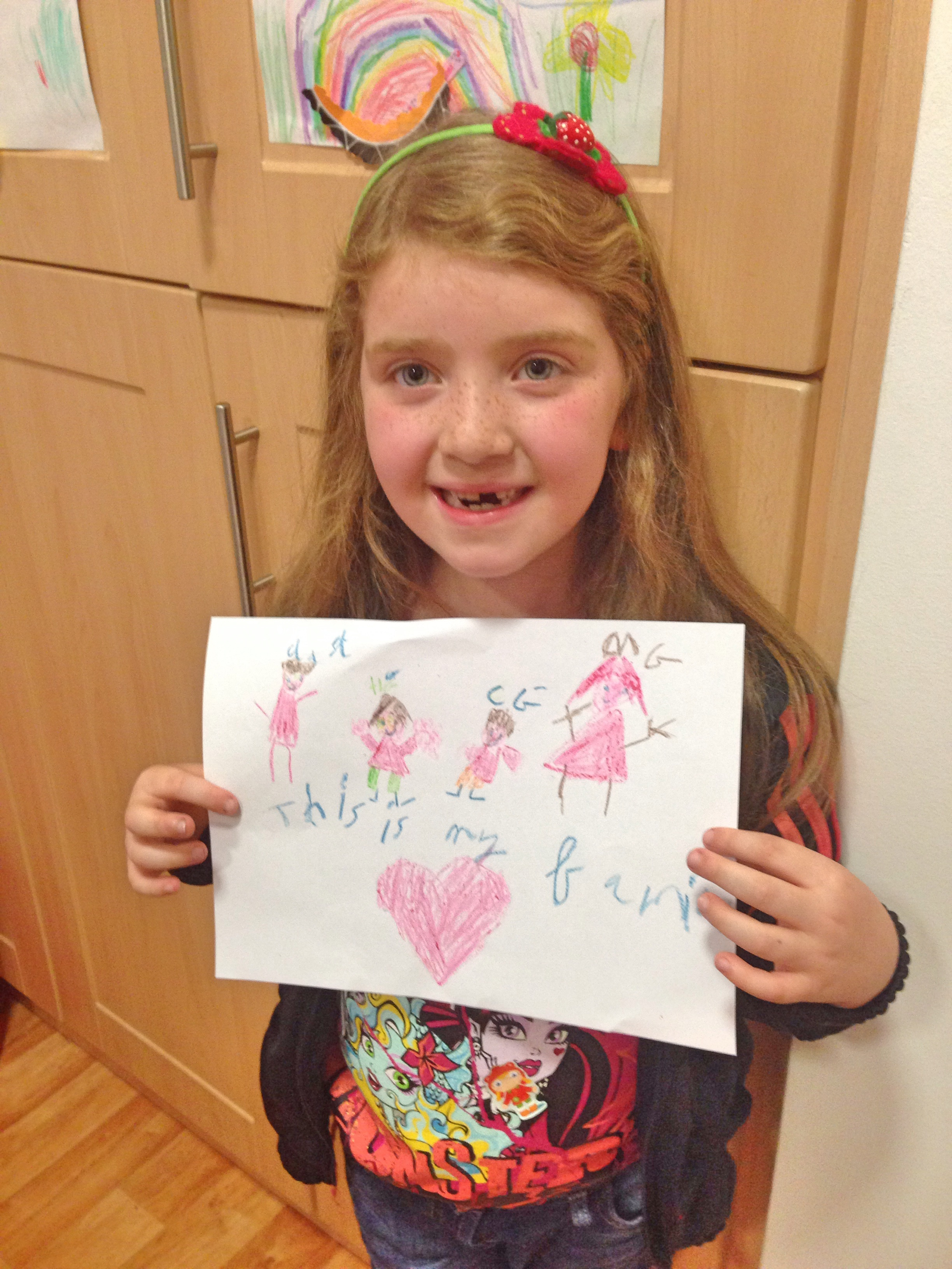 Hailey with her new drawing .x