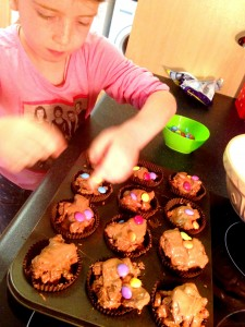 Scoop the mixture into cupcake cases and decorate with Smarties