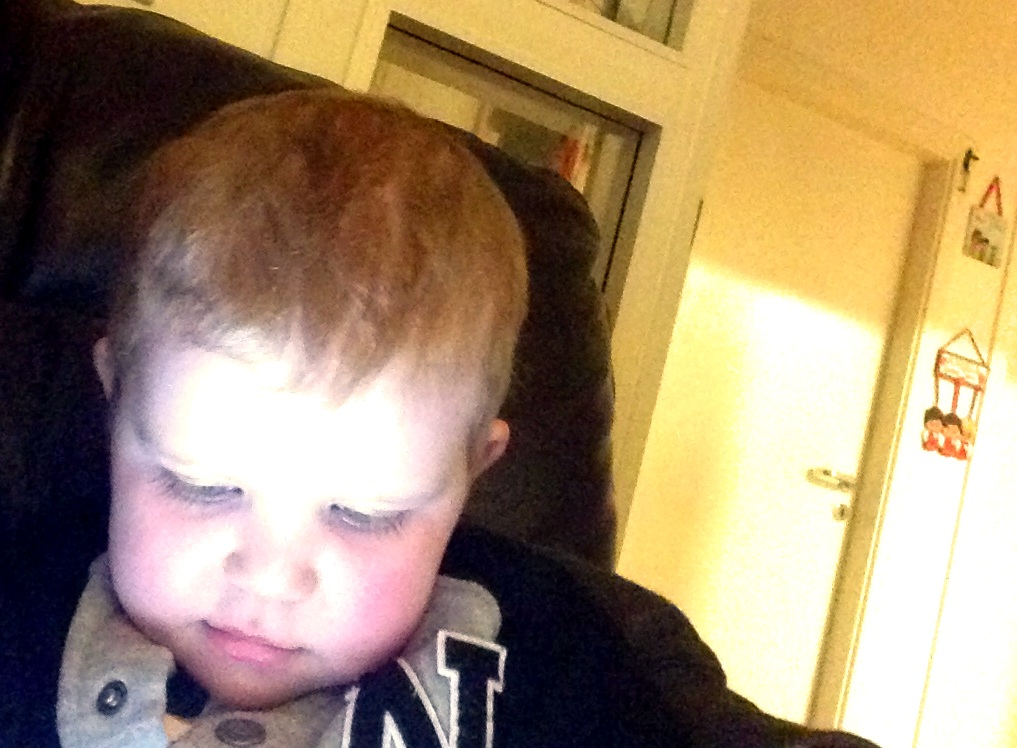 My little puddin playing on his ipad.x